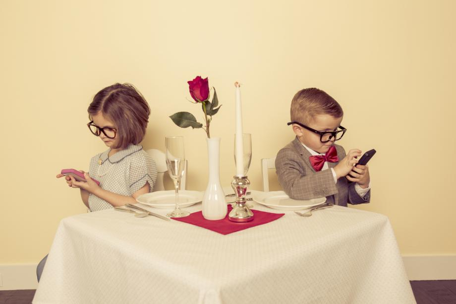 on mobile phones and ignoring each other