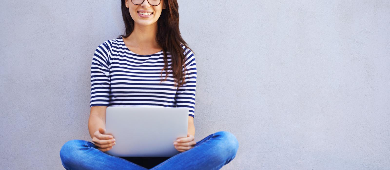 blogger completing survey on laptop