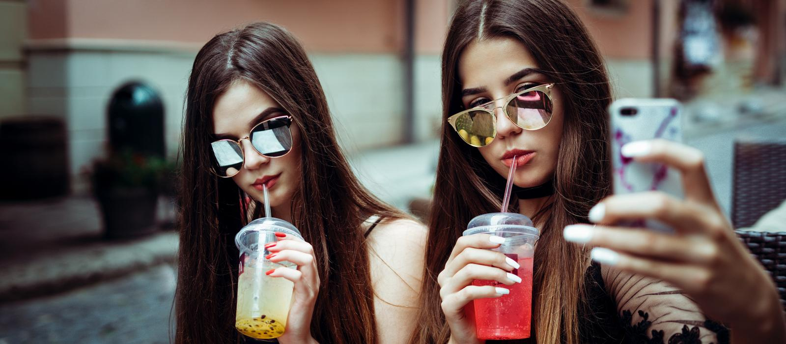 Girls drinking milkshakes
