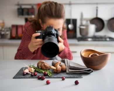 Woman photographs food