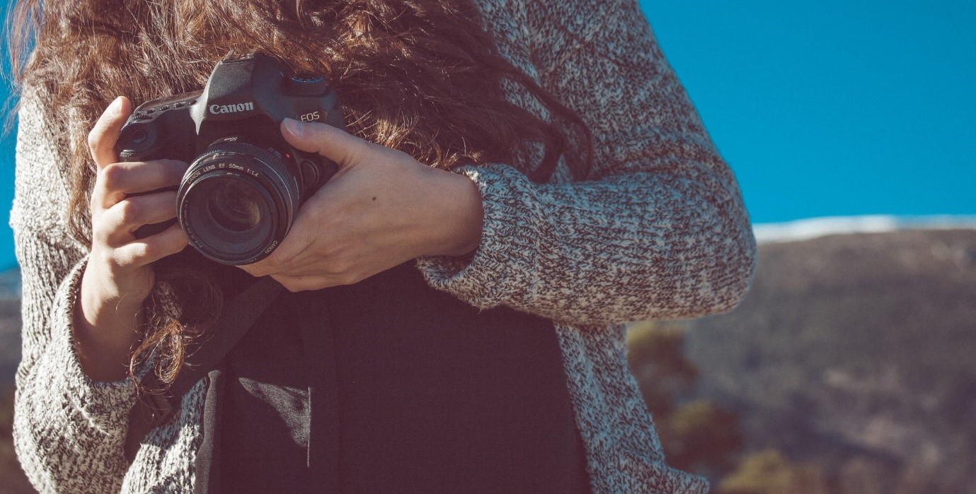 How to take good photos – close up of woman holding camera