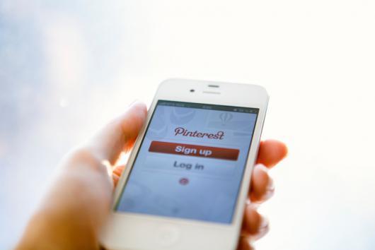 iphone with pinterest app open